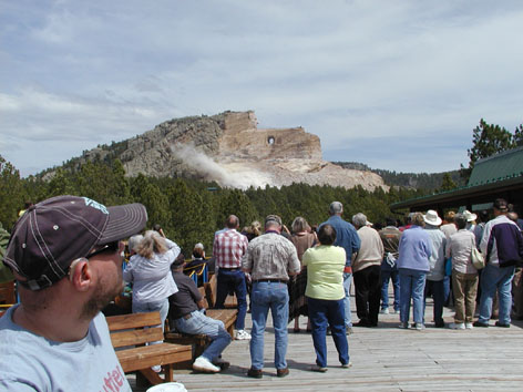 People watching dust from an explosion on the mountain. Tony in the foreground.