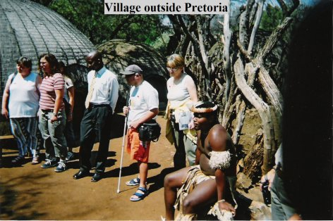 Group of tourists and a local tribal African