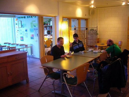 Tony with Ryan and David in the dining room of the hostel in Reykjavik
