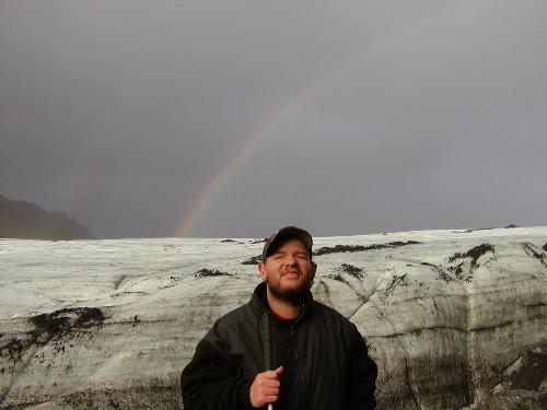 Tony at Myrdalsjokull glacier with rainbow in the background