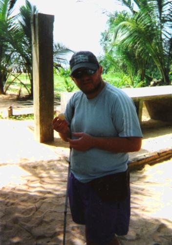 Tony feeling a turtle egg retrieved from the sand at the Kosgoda Turtle Hatchery, south coast of Sri Lanka, November