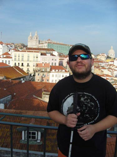 Tony with a view behind at a lookout in Alfama district
