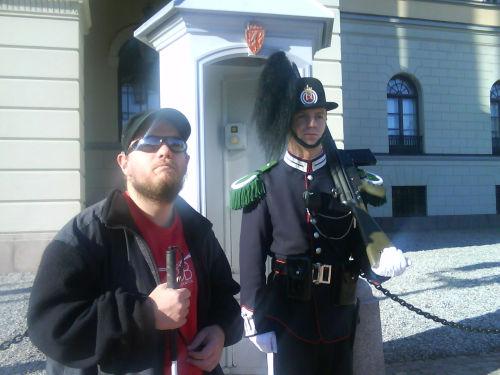 Tony beside a guard outside the King's Castle in Oslo