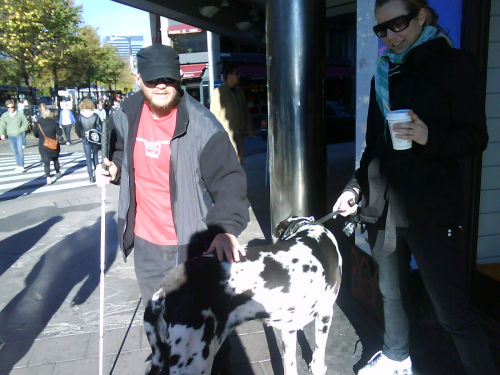 Tony with his hand on a Great Dane