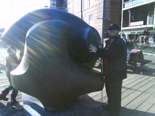Tony touching sculpture