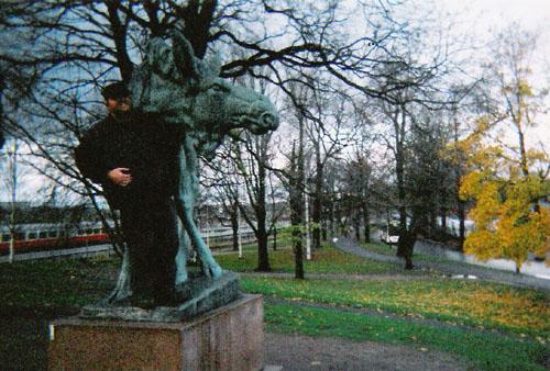 Tony standing in front of an elk statue