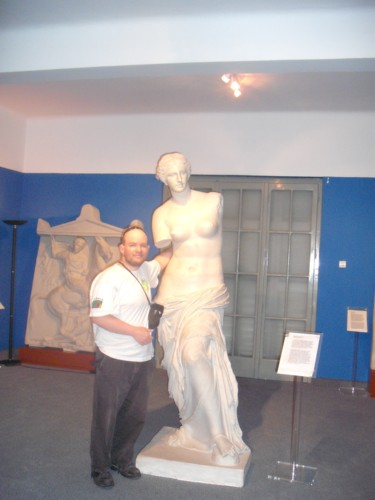 Tony feeling a copy of Venus de Milo in the Tactile Museum.