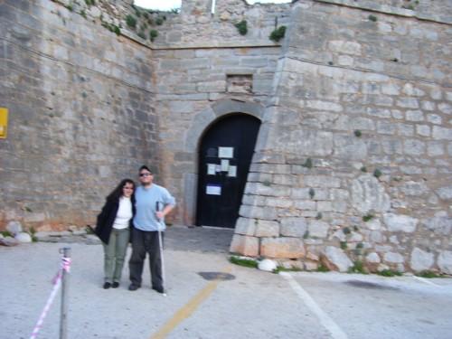 Tony and Tatiana stood at gate to castle