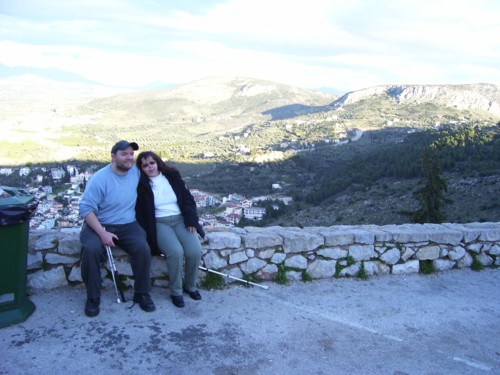 Tony and Tatiana high up with view of Nafplio City in background