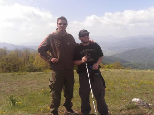 Tony and Petar on a grassy hillside near Krusevo city. It is known locally as Meckin Kamen (Bear's Rock).