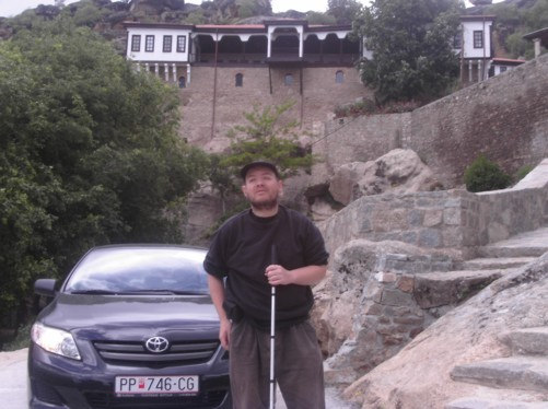 Tony with the monastery of St Archangel Michael behind him.