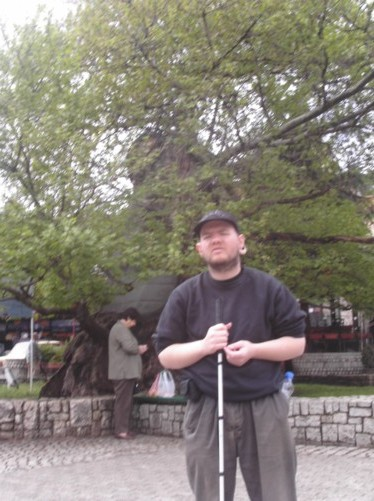 Tony in a small square that contains a large oak tree which is said to be 1000 years old.