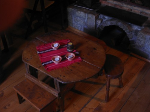 Wooden table inside guesthouse.