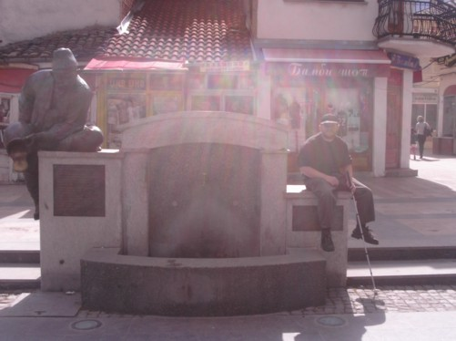 Tony sat by a statue of Itar Pejo, a figure in Macedonian folklore, known for his wit and wisdom. The statue is by a 200 year old drinking tap that Pejo is reputed to have visited.