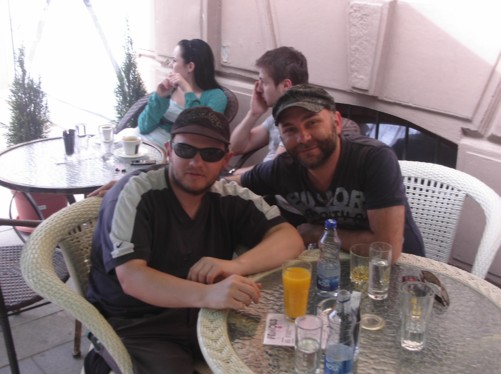 Tony sitting outside a café with the Australian-Macedonian owner Sash.