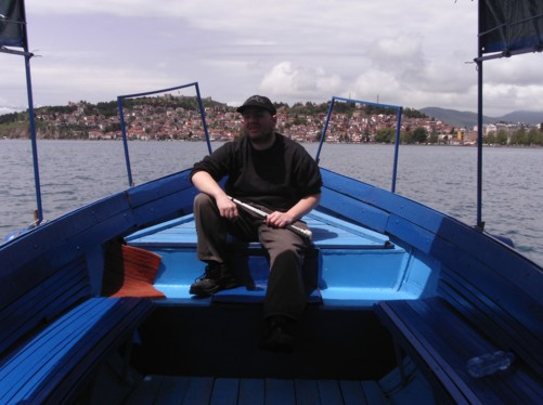 View of Tony in a small boat on Lake Ohrid.