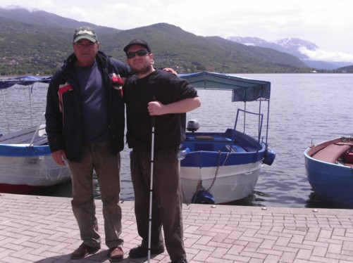 Tony back on dry land with the boat's local skipper.