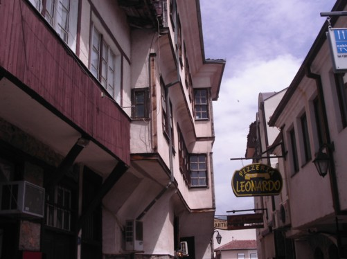 A narrow street in Ohrid's old town. Traditional houses with the upper stories hanging over the street. Houses in interesting style, stone on wood no cement!