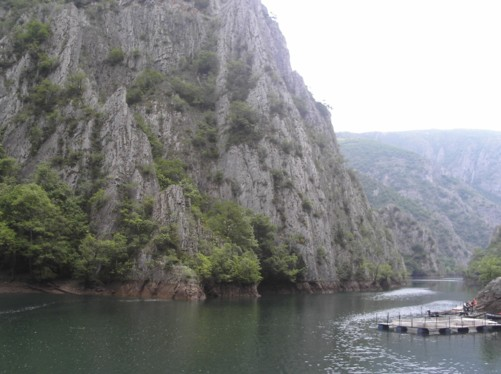 View of Lake Matka with the vertical cliffs of Treska canyon behind.