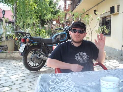 Tony in the garden of City Hostel.