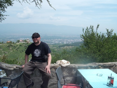 Tony at a café in grounds of St. Panteleimon with good views down the mountain towards Skopje City.