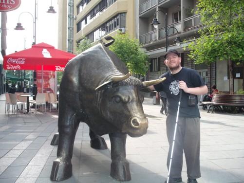 Tony next to a bull statue.