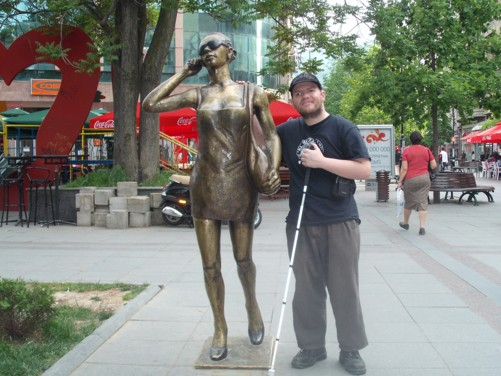 Tony beside a new statue of a sexy, young lady talking on a mobile phone.