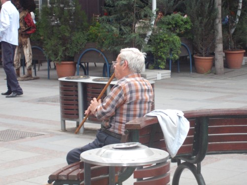 Man playing a flute.