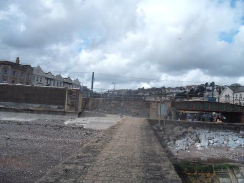 View of railway line and bridge from Dawlish beach.