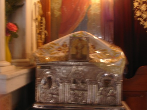 Inside the church next to Agios Nektarios Monastery. The picture shows a tomb containing the skull and bones of St. Nektarios, 1846-1920, who was known for his heeling powers.