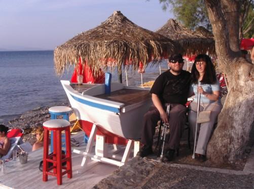 Tony and Tatiana sitting at a beach-side café.