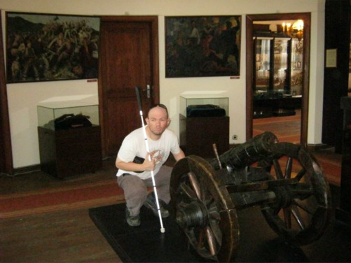 Tony beside a small canon in the Historical Museum.