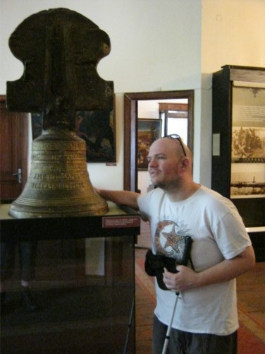 Tony by a church bell, Historical Museum.