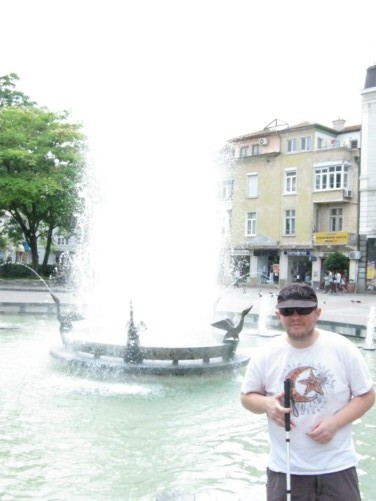 Tony by fountains in Plovdiv's main square.