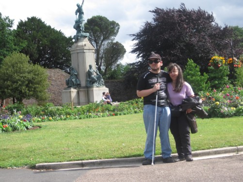 Tony and Tatiana in Northernhay Gardens. Behind them is the War Memorial, erected in 1923 by local sculptor John Angel.