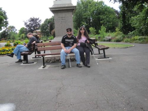 Tony and Tatiana sitting in Northernhay Gardens.