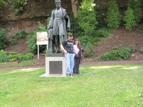Tony and Tatiana beside a statue of William Reginald Courtenay