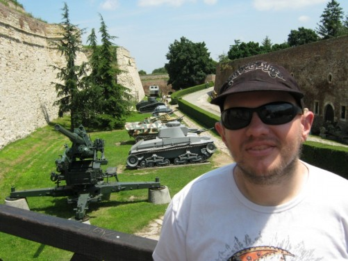 Tony at Kalemegdan Fortress. Behind him a display of old tanks and other military hardware.