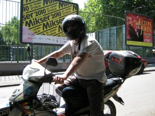 Tony sitting on motorbike.