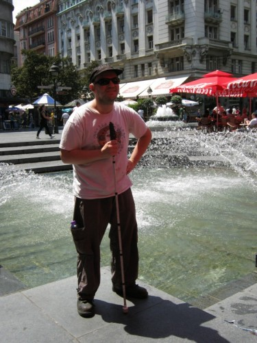 Tony by a large fountain in Republic Square, city centre.