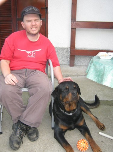 Tony with a large Alsation dog named Ringo at the Garden Hostel.