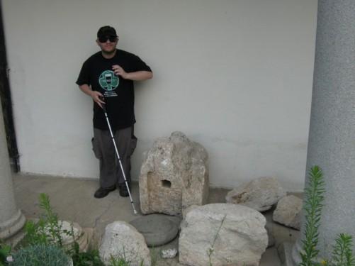 Tony by stone artefacts at Mediana.