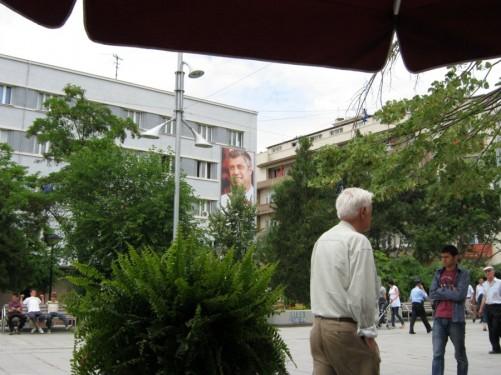 People walking along Rruga Nena Tereze (Mother Teresa Street). This is the city's main pedestrianised shopping street.