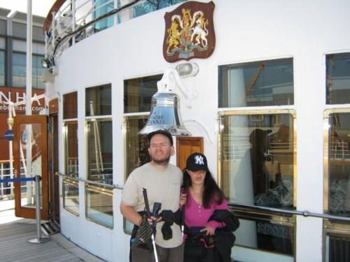 Tony and Tatiana in front of the ship's bell, the Royal Yacht Britannia.