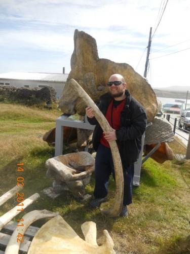 Tony holding a whale's rib bone.