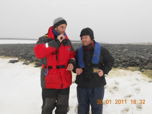 Tony on the ice on Half Moon Island, in conversation with a fellow passenger from America.