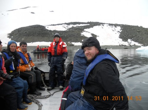 Tony with other passengers in the Zodiac heading back through the icebergs to the MV Ushuaia.