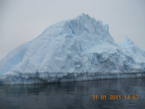 Passing an iceberg, in colour it has a distinct bluish tinge.