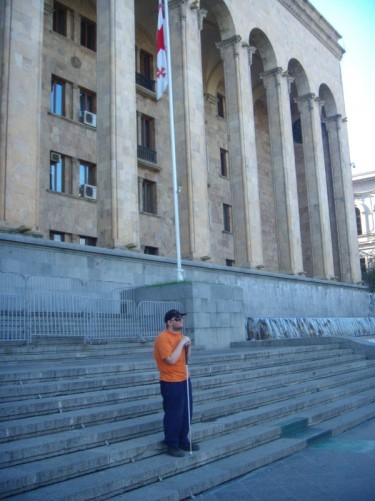 This is Tony outside Georgia's Parliament Building (House of Government) with the national flag of the Republic of Georgia.