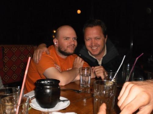 Tony and Italian man at restaurant.